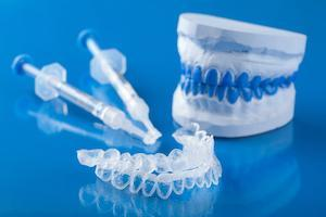 teeth whitening equipment on a blue table | st petersburg teeth whitening