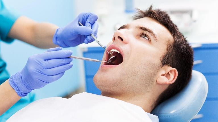 a man gets a dental exam | dentist in St. Petersburg, FL